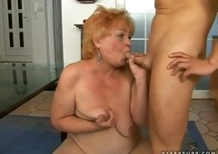 Sex-starved granny performs sexual blowjob to her horny lover