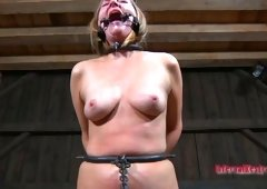 Fuckable golden-haired slut kneels down waiting for her execution