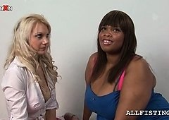 Tempting blondie licks a lez BBW ebony's tits