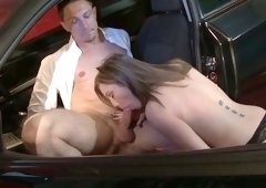 Bonny darksome haired girlie in hawt stockings sucks hard cock of handsome boy in car