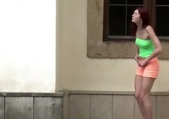 Perverted red haired baby in mini skirt pees on the backwards of house